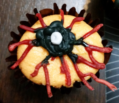An eyeball with red nerves cupcake topper