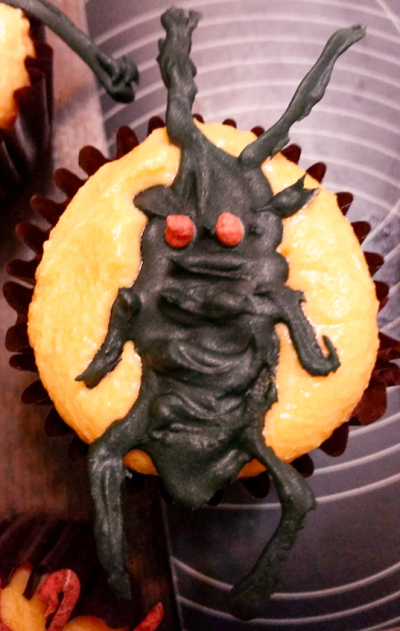 A cockroach cupcake topper